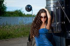 Sexy brunette woman and truck Royalty Free Stock Photography