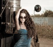 Sexy brunette woman and truck Royalty Free Stock Photos