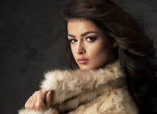 Sexy brunette woman wear fur Stock Photos