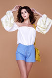 Sexy brunette woman wear short blue cotton short and silk summer. Collection blouse perfect body shape diet skin tan hold accessory bag glamour model fashion Royalty Free Stock Photos