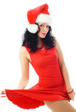 brunette woman wearing Santa's hat Royalty Free Stock Images