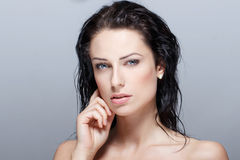 Sexy brunette woman with wet hair beauty Royalty Free Stock Images