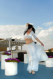 Sexy brunette woman in white long skirt dansing Royalty Free Stock Images