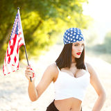 Sexy brunette woman wih USA flag outdoor Royalty Free Stock Image