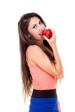 Sexy brunette young woman eating red apple. Stock Photos
