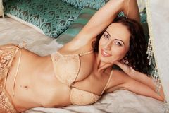Sexy brunette young woman wearing beige lingerie Royalty Free Stock Images