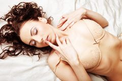 Sexy brunette young woman wearing beige lingerie Royalty Free Stock Image