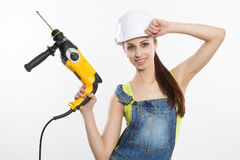 Sexy builder woman with a drill in her hands Royalty Free Stock Photography