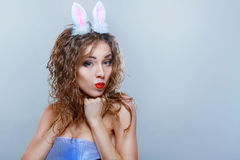 Sexy bunny girl. Isolated over pink background Royalty Free Stock Photo
