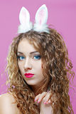 Sexy bunny girl. Isolated over pink background Stock Photo