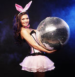 Sexy bunny-girl with disco ball Stock Photo