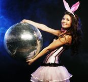 Sexy bunny-girl with disco ball Royalty Free Stock Images