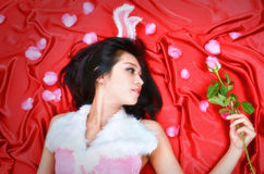 Sexy bunny girl hold pink rose Stock Photo