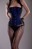 Sexy burleske vrouw in zwart en blauw korset Stock Foto's