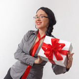 Sexy business lady with gift box with red ribbon Stock Photography