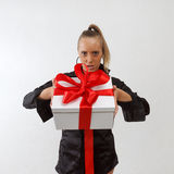 business lady holding gift box with red ribbon Stock Image