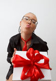 Sexy business lady holding gift box with red ribbon Stock Images