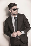 Sexy business man with sunglasses holding his suit Stock Image