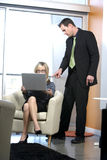 Business woman. A business woman takes notes for her boss stock photography