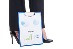 Sexy business woman feet and financial reports with charts Stock Photo