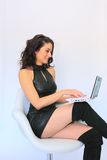 Sexy business woman with laptop Royalty Free Stock Image