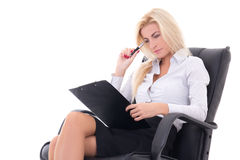 Sexy business woman sitting on office chair with clipboard and p. En isolated on white background Stock Images