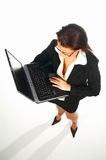 Business women 2. Business women isolated on white holding laptop computer stock photography