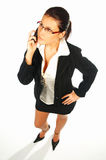 Business women 2. Business women isolated on white with cell phone royalty free stock image