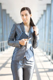 Sexy businesswoman on the blue modern background Royalty Free Stock Photo