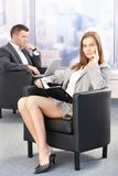 Sexy businesswoman during conference break Stock Photography