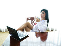 Sexy businesswoman with laptop Stock Photos