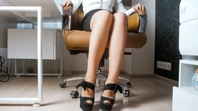 Sexy young businesswoman in provocative clothes sitting in armchair. Sexy businesswoman in provocative clothes sitting in armchair Royalty Free Stock Photos