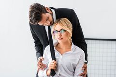 Free Sexy Businesswoman Pulling Tie Of Businessman Royalty Free Stock Image - 177381226