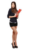 Sexy businesswoman with red folder Royalty Free Stock Image