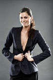 Sexy businesswoman with suit over nude breasts Stock Images