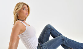 Sexy and buxom blonde model in white tank Royalty Free Stock Photo