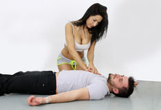 Cardiac massage. Women doing CPR to an unconscious man stock images