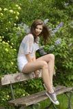 Sexy casual girl in green garden Royalty Free Stock Photography
