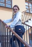 Caucasian Female Posing on Stairs in The City. royalty free stock images
