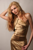 caucasian girl in gold dress Royalty Free Stock Images