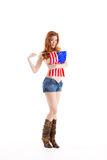 Sexy Caucasian woman with American national flag. Topless Caucasian woman holding American flag Royalty Free Stock Photography