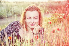 caucasian woman and corn poppy flowers, beauty filter Royalty Free Stock Photography