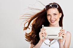 Sexy caucasian woman with purse Royalty Free Stock Image
