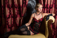 Sexy on a chaise-longue Royalty Free Stock Photo