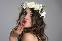 Sexy charming woman blowing kiss turning back and looking over the shoulder Stock Images