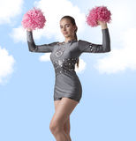 Sexy cheerleader raises pompom Stock Images