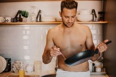Chef with naked body cooking in the home kitchen. Chef with naked body cooking in the home kitchen stock image