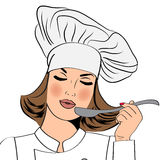 Sexy chef woman in uniform taste the food Royalty Free Stock Image