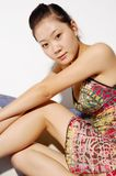 Sexy Chinese Woman. A sexy Chinese woman in an elegant colorful dress Royalty Free Stock Photos