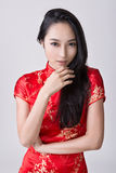 Sexy Chinese woman. Dress traditional cheongsam, closeup portrait Stock Image